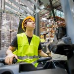 rsz focused asian warehouse worker with forklift at wo nuy6xhc min